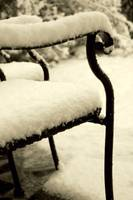 snow on chairs sepia