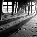 """San Clemente Pier Surfer"" by brandonpaulwatts"