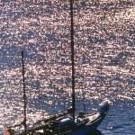 """Sailboat anchored at sunset in Hawaii"" by bob80"