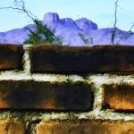 """Panorama Brick Wall and Mountain Range"" by johncorney"