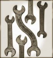 five antique wrenches on white background with sep