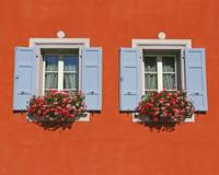 Red Wall With Two Windows