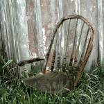 """Old chair in the grass"" by gwiley"