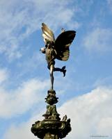 Eros Statue on blue sky