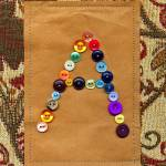 """Letter A with Vintage Buttons and Brown Paper Bag"" by Pumpkinbear"