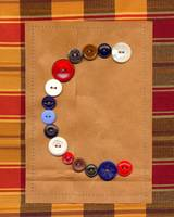 Letter C with Vintage Buttons and Brown Paper Bag