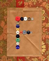 Letter F with Vintage Buttons and Brown Paper Bag