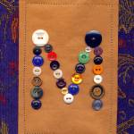 """Letter M with Vintage Buttons and Brown Paper Bag"" by Pumpkinbear"