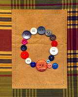 Letter Q with Vintage Buttons and Brown Paper Bag