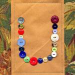 """Letter U with Vintage Buttons and Brown Paper Bag"" by Pumpkinbear"