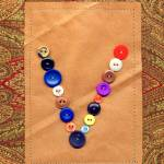 """Letter V with Vintage Buttons and Brown Paper Bag"" by Pumpkinbear"