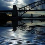 """Sydney Harbour Bridge with sky and reflection"" by SheilaSmart"