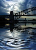 Sydney Harbour Bridge with sky and reflection