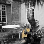 """Strumming in a Courtyard"" by rachelro"