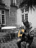 Strumming in a Courtyard