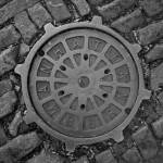 """Manhattan Manhole Cover"" by shep"