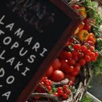 """Lovely food display in Santorini"" by travelingmcmahans"