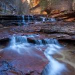 """Stone Cascades, Left Fork Creek, Zion National Par"" by HiddenLightPhotography"