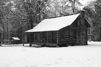 Snowy log cabin