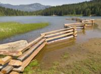 Wooden fence in the Lost lake , Whistler , Canada