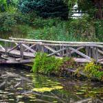 """Wooden bridge over water"" by PositiveImage"