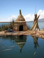 On a floating island on Lake Titicaca