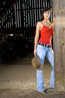 Cowgirl in barn doorway
