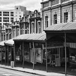 """Upper Queen Street Shops in Black and White"" by johncorney"