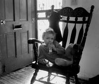 Child in rocking chair