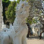 """Dragon Guarding the Chedi at Wat Mahawan Chiang Ma"" by vampireskunk"