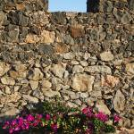 """Stone Wall with Windows Spain"" by RobynL"