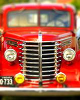 Antique red pick up truck full frame chrome grill