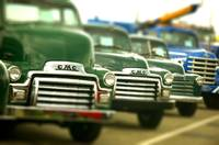 Lot a green old trucks