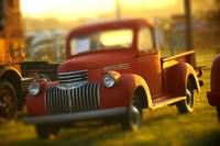 Old Chevy Stove bolt pickup truck at sunset