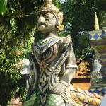 """Guardian of the Chedi Wat Ket Karam Chiang Mai"" by vampireskunk"