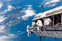 Astronauts participate in extravehicular activity.