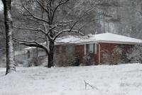 brick house in snow