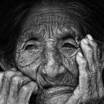 """elderly woman face_it0217"" by brazilphotos"