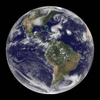 View of the full Earth and four storm systems.