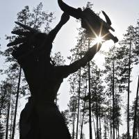 """Sun Worshipper Statue near Glacier National Park"" by Jim Crotty"
