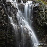 Waterfall at Logan Pass Glacier National Park by Jim Crotty