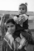 Mom Carrying Daughter on Shoulder bw