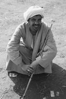 Camel Trader Squatting on the Ground bw