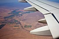 Airplane Wing Over Landscape