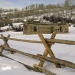 """Shane cabin behind pole fence"" by SamSherman"