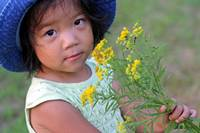 Asian girl picking flowers