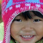 """Asian girl in knitted winter hat"" by BehindTheLens"