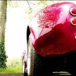 """AC Cobra Parked in Red"" by oopsfotos"