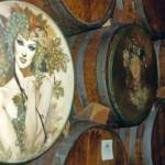 """Woman on Wine Barrel"" by kimmanleyort"