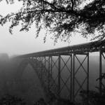 """New River Bridge Misty Morning"" by ImagesByJoanzy"